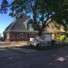 Nieuwbouw stolpboerderij met winkel te Oostwoud.
