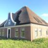 Stolpboerderij aan het Oudelandsdijkje te Hensbroek